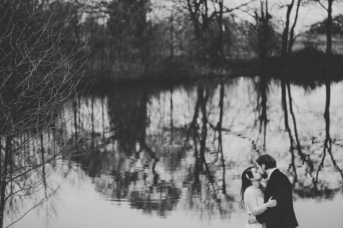bride and groom kiss near the lake, styal lodge wedding photography, styal lodge wedding photographer, manchester wedding photographer, manchester wedding photography, cheshire wedding photographer, cheshire wedding photography