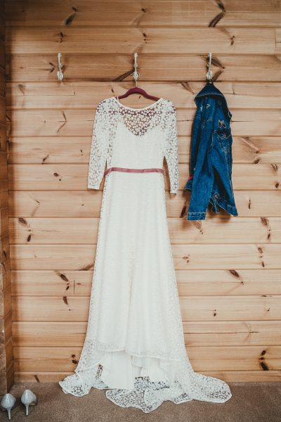 wedding dress and denim jacket hanging side by side, styal lodge wedding photography, styal lodge wedding photographer, manchester wedding photographer, manchester wedding photography, cheshire wedding photographer, cheshire wedding photography