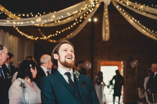 groom laughing as bride and her mum enter the wedding room, styal lodge wedding photography, styal lodge wedding photographer, manchester wedding photographer, manchester wedding photography, cheshire wedding photographer, cheshire wedding photography