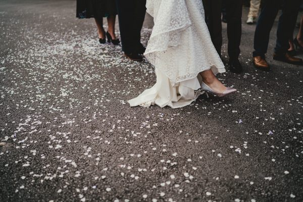 bottom of the brides wedding dress as she steps on to confetti, styal lodge wedding photography, styal lodge wedding photographer, manchester wedding photographer, manchester wedding photography, cheshire wedding photographer, cheshire wedding photography