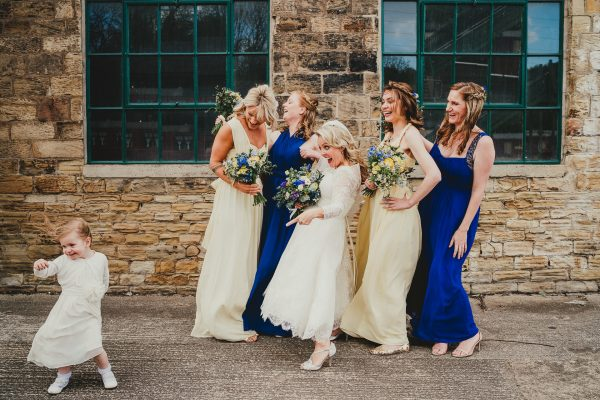 bridemaids laughing as little flower girl runs in front of them, elsecar heritage centre wedding photographer, elsecar heritage centre wedding photography, elsecar heritage centre wedding, ayesha photographer, manchester wedding photographer, manchester wedding photography, sheffield wedding photographer, sheffield wedding photography, barnsley wedding photographer, innercity weddings