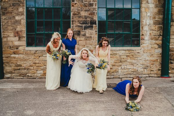 bride and bridesmaid laughing and one bridesmaid lies on the floor, elsecar heritage centre wedding photographer, elsecar heritage centre wedding photography, elsecar heritage centre wedding, ayesha photographer, manchester wedding photographer, manchester wedding photography, sheffield wedding photographer, sheffield wedding photography, barnsley wedding photographer, innercity weddings