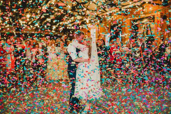 bride and groom dancing with confetti canons going off around them and lots of colourful confetti raining down on them, elsecar heritage centre wedding photographer, elsecar heritage centre wedding photography, elsecar heritage centre wedding, ayesha photographer, manchester wedding photographer, manchester wedding photography, sheffield wedding photographer, sheffield wedding photography, barnsley wedding photographer, innercity weddings