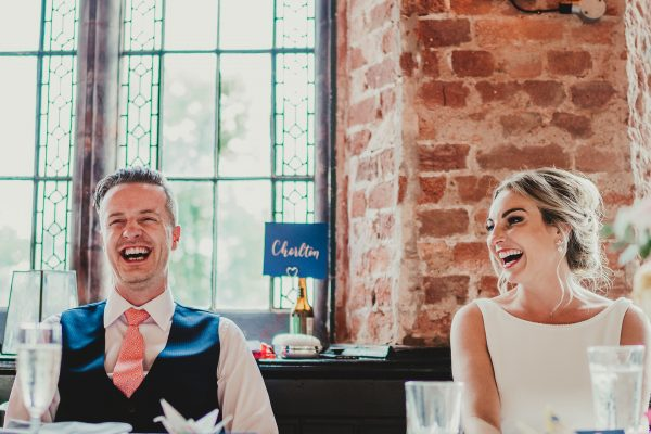 bride and groom laughing whilst at the top table, the courthouse cheshire wedding photographer, the courthouse cheshire wedding photography, the courthouse cheshire wedding, lost and found knutsford wedding, lost and found knutsford wedding photographer, lost and found knutsford wedding photography, cheshire wedding photographer, cheshire wedding photography, manchester wedding photographer, manchester wedding photography, ayesha photography, creative manchester wedding photographer, creative cheshire wedding photography, alternative manchester wedding photographer,