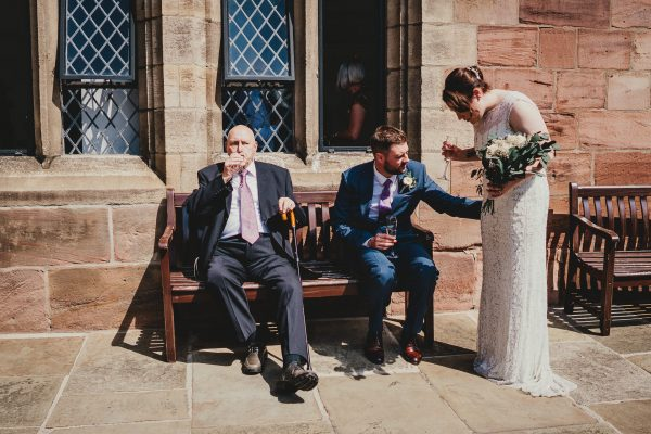 grandad and groom sat on the bench whilst groom admires brides dress, chetham's library wedding photographer, chetham's library wedding photography, lock 91 wedding photographer, lock 91 wedding photography, manchester wedding photographer, manchester wedding photography, cool manchester wedding, creative manchester wedding photographer
