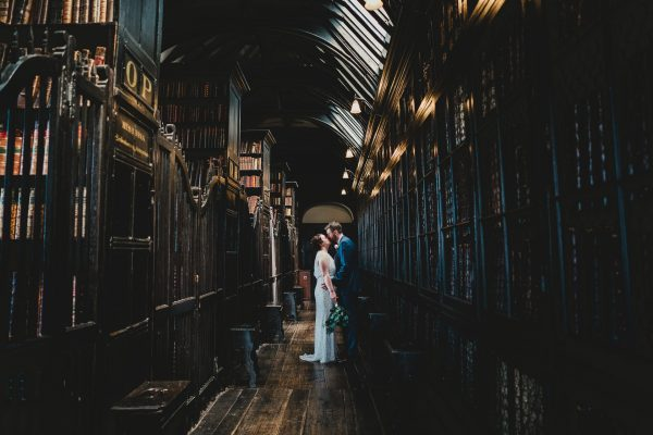 bride and groom stand in the old library at chetham's library and kiss, chetham's library wedding photographer, chetham's library wedding photography, lock 91 wedding photographer, lock 91 wedding photography, manchester wedding photographer, manchester wedding photography, cool manchester wedding, creative manchester wedding photographer