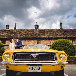 bride and groom lean against a yellow convertible mustang, chetham's library wedding photographer, chetham's library wedding photography, lock 91 wedding photographer, lock 91 wedding photography, manchester wedding photographer, manchester wedding photography, cool manchester wedding, creative manchester wedding photographer