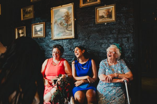 wedding guests laughing inside of lock 91, chetham's library wedding photographer, chetham's library wedding photography, lock 91 wedding photographer, lock 91 wedding photography, manchester wedding photographer, manchester wedding photography, cool manchester wedding, creative manchester wedding photographer