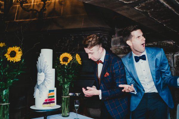 grooms cut the wedding cake, chethams library wedding photographer, chethams library wedding photography, manchester wedding photographer, manchester wedding photography, manchester city centre wedding photographer, same sex wedding manchester, ayesha photography, creative manchester wedding photographer, stylish wedding photographer manchester, fun wedding photographer manchester