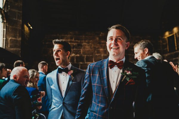 two grooms exit their wedding ceremony, chethams library wedding photographer, chethams library wedding photography, manchester wedding photographer, manchester wedding photography, manchester city centre wedding photographer, same sex wedding manchester, ayesha photography, creative manchester wedding photographer, stylish wedding photographer manchester, fun wedding photographer manchester