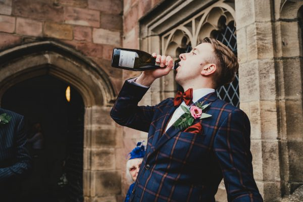 a groom drinks from the prosecco bottle, chethams library wedding photographer, chethams library wedding photography, manchester wedding photographer, manchester wedding photography, manchester city centre wedding photographer, same sex wedding manchester, ayesha photography, creative manchester wedding photographer, stylish wedding photographer manchester, fun wedding photographer manchester