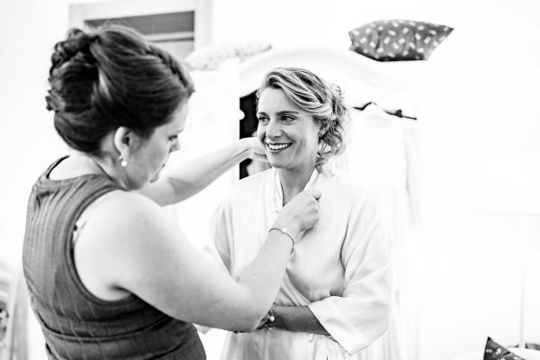 bridesmaid puts necklace on bride, borgo tre rose montepulciano wedding, montepulciano wedding photographer, montepuliciano wedding photography, italy wedding photographer, italy wedding photography, lake como wedding photography, lake como wedding photography, ayesha photography, destination wedding photographer, destination wedding, manchester wedding photographer, manchester wedding photography, uk wedding photography,