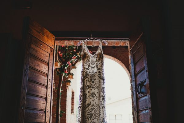 wedding dress hangs in a doorway, borgo tre rose montepulciano wedding, montepulciano wedding photographer, montepuliciano wedding photography, italy wedding photographer, italy wedding photography, lake como wedding photography, lake como wedding photography, ayesha photography, destination wedding photographer, destination wedding, manchester wedding photographer, manchester wedding photography, uk wedding photography,
