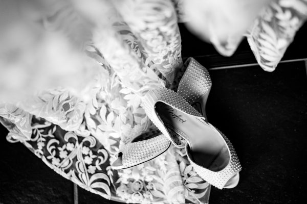 wedding shoes next to wedding dress, borgo tre rose montepulciano wedding, montepulciano wedding photographer, montepuliciano wedding photography, italy wedding photographer, italy wedding photography, lake como wedding photography, lake como wedding photography, ayesha photography, destination wedding photographer, destination wedding, manchester wedding photographer, manchester wedding photography, uk wedding photography,