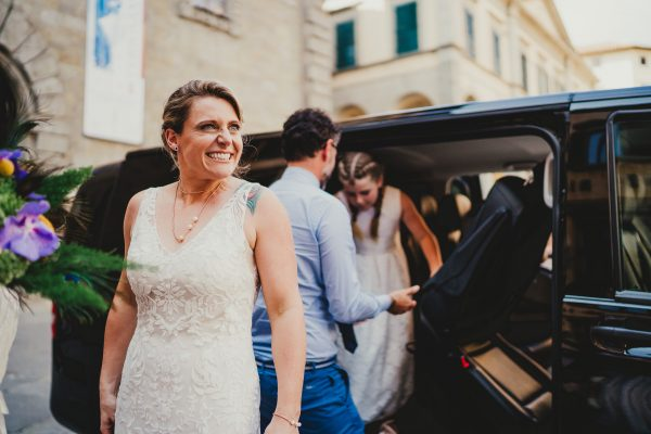 bride gets out of taxi outside cortona town hall in italy, borgo tre rose montepulciano wedding, montepulciano wedding photographer, montepuliciano wedding photography, italy wedding photographer, italy wedding photography, lake como wedding photography, lake como wedding photography, ayesha photography, destination wedding photographer, destination wedding, manchester wedding photographer, manchester wedding photography, uk wedding photography, cortona wedding photographer, cortona wedding,