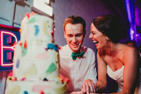 bride and groom cut the cake, loft studios wedding, loft studios wedding photography, loft studios wedding photographer, loft studios london, london wedding photographer, london wedding photography, urban london wedding, manchester wedding photographer, ayesha photography, humanist wedding in london, colourful wedding,