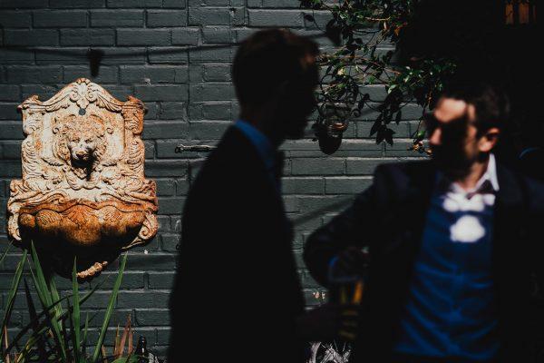 groom chatting to friend, loft studios wedding, loft studios wedding photography, loft studios wedding photographer, loft studios london, london wedding photographer, london wedding photography, urban london wedding, manchester wedding photographer, ayesha photography, humanist wedding in london, colourful wedding,