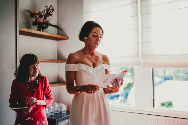 bride reads out wedding card from groom, loft studios wedding, loft studios wedding photography, loft studios wedding photographer, loft studios london, london wedding photographer, london wedding photography, urban london wedding, manchester wedding photographer, ayesha photography, humanist wedding in london, colourful wedding,