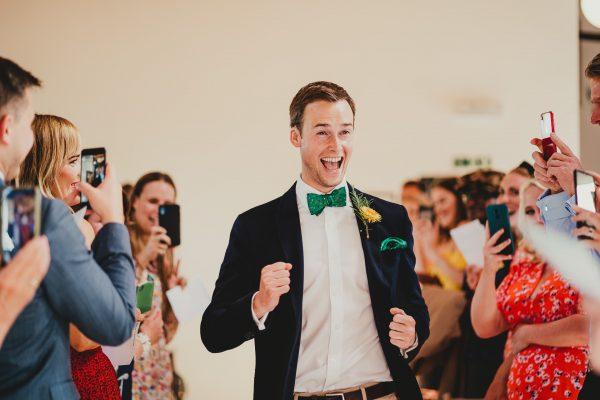 groom dances up the ailse, loft studios wedding, loft studios wedding photography, loft studios wedding photographer, loft studios london, london wedding photographer, london wedding photography, urban london wedding, manchester wedding photographer, ayesha photography, humanist wedding in london, colourful wedding,