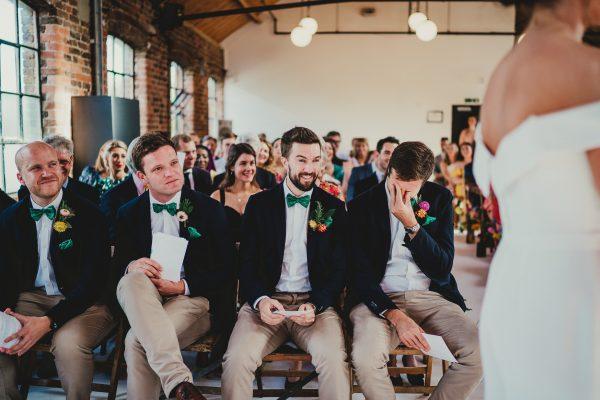 groomsmen sat in the ceremony room, loft studios wedding, loft studios wedding photography, loft studios wedding photographer, loft studios london, london wedding photographer, london wedding photography, urban london wedding, manchester wedding photographer, ayesha photography, humanist wedding in london, colourful wedding,