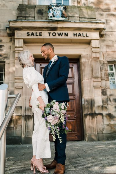 bride and groom outside sale town hall