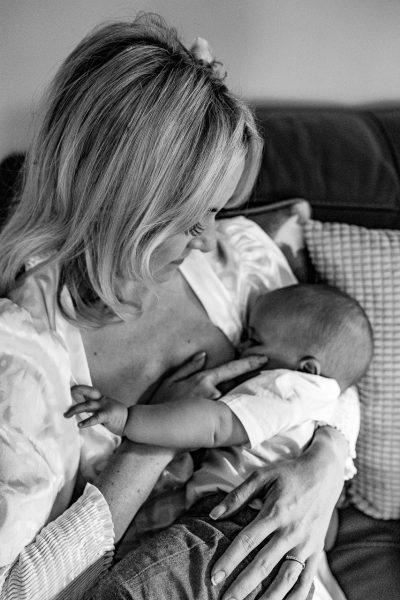 bride breast feeding her baby boy