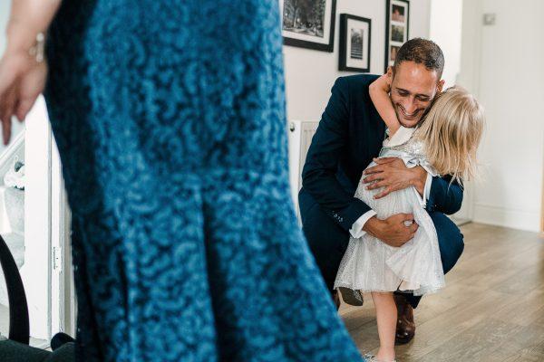 daughter hugs her dad
