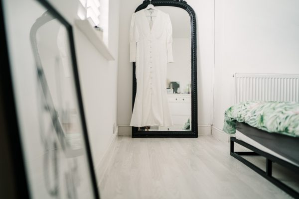 wedding dress hanging on a mirror