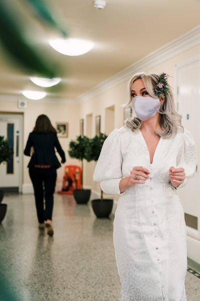 bride wears face mask