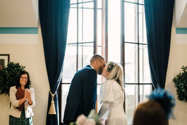 bride and grooms first kiss at sale town hall