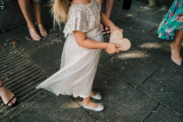 flower girl holds a confetti heart at sale town hall