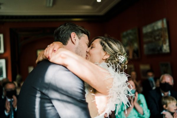 bride and grooms first kiss once married