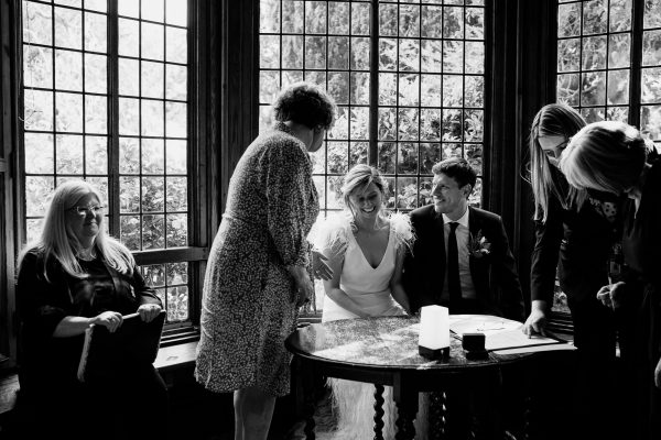 signing the register after a wedding ceremony