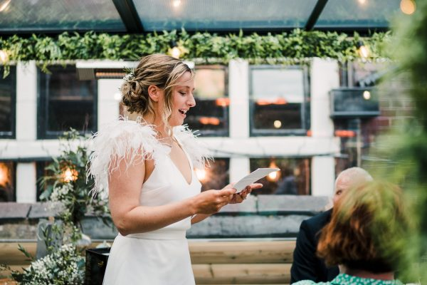 bride gives a speech to her guests at Zitano in chorlton whilst wearing charlie brear dress