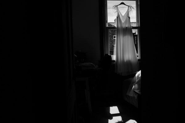 Charlie Brear wedding dress hangs up