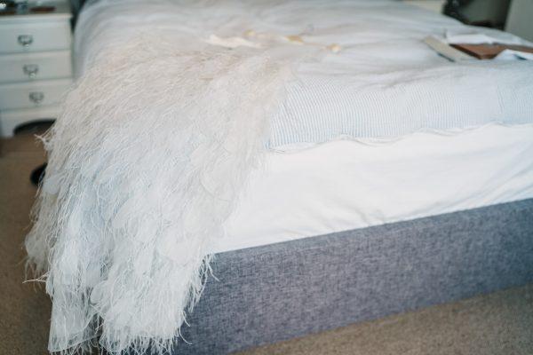 Charlie Brear wedding dress lay on bed