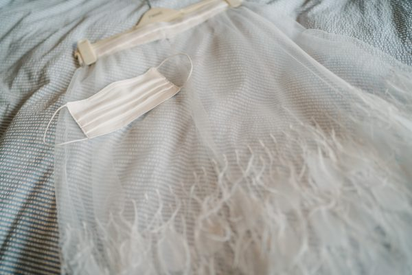 Charlie Brear wedding dress with a covid face mask