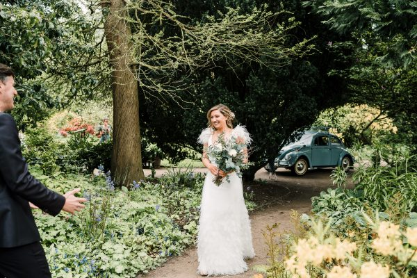 bride sees groom for the first time in the gardens before their ceremony