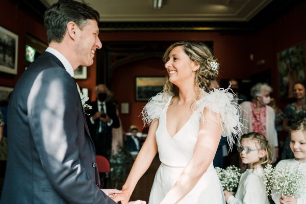 bride and groom meet at the altar at the Didsbury Parsonage